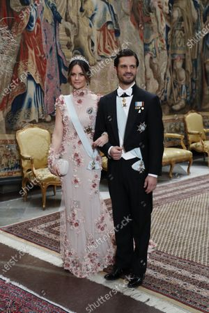 Princess Sofia of Sweden and Prince Carl Philip arrive for the traditional dinner for the Nobel laureates at the Royal Palace