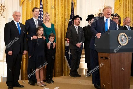 Donald Trump, Ivanka Trump, Jared Kushner, Mike Pence, Arabella Kushner, Theodore Kushner, Melania Trump. President Donald Trump with, from left, Vice President Mike Pence, Jared Kushner and Ivanka Trump and their children Arabella Kushner and Theodore Kushner, speaks during a Hanukkah reception in the East Room of the White House, in Washington