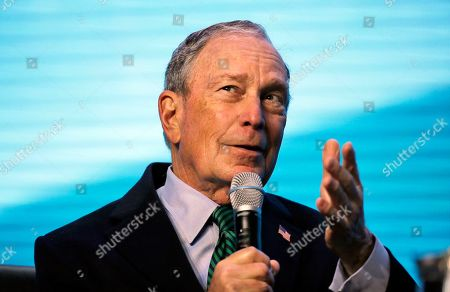 Democratic Presidential candidate and former New York City Mayor Michael Bloomberg gestures while taking part in an on-stage conversation with former California Gov. Jerry Brown at the American Geophysical Union fall meeting, in San Francisco. Bloomberg made his first visit to California as a Democratic presidential candidate, appearing earlier with the mayor of Stockton who's championed universal basic income. Bloomberg and Brown talked about America's Pledge, bringing together leaders to ensure the U.S. remains a global leader in reducing emissions and delivering the goals of the Paris Agreement