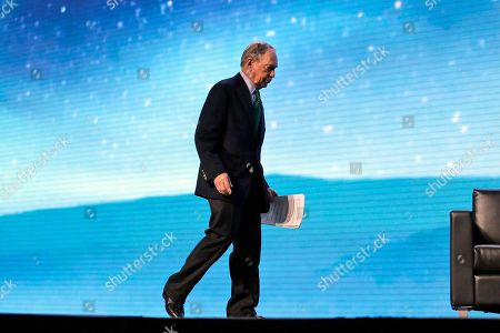 Stock Photo of Democratic Presidential candidate and former New York City Mayor Michael Bloomberg walks on stage before taking part in a conversation with former California Gov. Jerry Brown at the American Geophysical Union fall meeting, in San Francisco. Bloomberg made his first visit to California as a Democratic presidential candidate, appearing earlier with the mayor of Stockton who's championed universal basic income. Bloomberg and Brown talked about America's Pledge, bringing together leaders to ensure the U.S. remains a global leader in reducing emissions and delivering the goals of the Paris Agreement