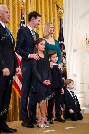 (L-R, top) US Vice President Mike Pence, Jared Kushner, Ivanka trump and their three children Arabella (L, bottom), Joseph (C, bottom) and Theodore (R, bottom) listen as US President Donald J. Trump speaks at a Hanukkah reception in the East Room of the White House in Washington, DC, USA, 11 December 2019. Trump used the occasion to sign an Executive Order to 'further the fight against the rise of anti-Semitism in the United States'.