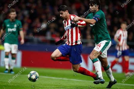 Alvaro Morata of Atletico Madrid and Vedran Corluka of Lokomotiv