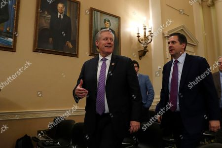 Rep. Mark Meadows, R-N.C., left, and Rep. Devin Nunes, R-Calif., arrive to watch a House Judiciary Committee markup of the articles of impeachment against President Donald Trump, on Capitol Hill in Washington