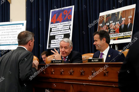 Rep. Ken Buck, R-Colo., center, talks with Rep. Kelly Armstrong, R-N.D., left, and Rep. John Ratcliffe, R-Texas, before a House Judiciary Committee markup of the articles of impeachment against President Donald Trump, on Capitol Hill in Washington