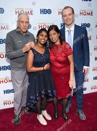 "Jon Alpert, Livya Dsouza, Maria Fernandez, Matthew O'Neill. Filmmakers Jon Alpert, left, and Matthew O'Neill pose with subjects of the film Livya Dsouza, left, and Maria Fernandez at the HBO Documentary Films premiere of ""Finding the Way Home"" at 30 Hudson Yards, in New York"