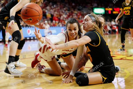 Kristin Scott, Makenzie Meyer. Iowa State forward Kristin Scott fights for a loose ball with Iowa guard Makenzie Meyer, right, during the first half of an NCAA college basketball game, in Ames, Iowa