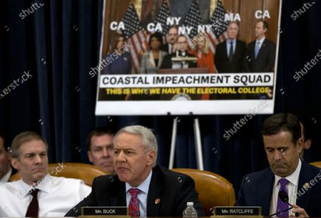 United States Representative Ken Buck (Republican of Colorado) speaks during a House Judiciary Committee markup of the articles of impeachment against President Donald Trump  At left is US Representative Jim Jordan (Republican of Ohio) and at right is US Representative John Ratcliffe (Republican of Texas).