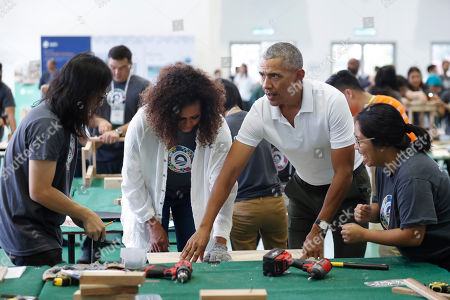 Barack Obama, Michelle Obama. Former U.S. President Barack Obama, second from right, assists former first lady Michelle, second from left, during a community services event on the sidelines of the Obama Foundation event in Kuala Lumpur, Malaysia, . The former president and the former first lady along with actress Julia Roberts attended inaugural Gathering of Rising Leaders in the Asia Pacific organized by the Obama Foundation