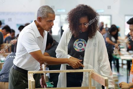 Barack Obama, Michelle Obama. Former U.S. President Barack Obama and former first lady Michelle participate in a community services event during the sidelines of the Obama Foundation in Kuala Lumpur, Malaysia, . The former president and first lady along with actress Julia Roberts attended the inaugural Gathering of Rising Leaders in the Asia Pacific organized by the Obama Foundation