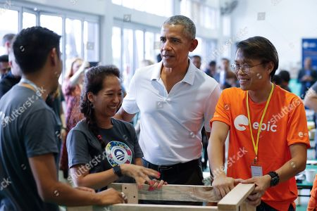 Former U.S. President Barack Obama participates in a community services event during the sidelines of the Obama Foundation in Kuala Lumpur, Malaysia, . The former president and first lady along with actress Julia Roberts attended the inaugural Gathering of Rising Leaders in the Asia Pacific organized by the Obama Foundation
