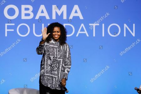 Former U.S. fist lady Michelle Obama waves as she attends an event for Obama Foundation in Kuala Lumpur, Malaysia, . Obama and actress Julia Roberts attended the inaugural Gathering of Rising Leaders in the Asia Pacific organized by the Obama Foundation