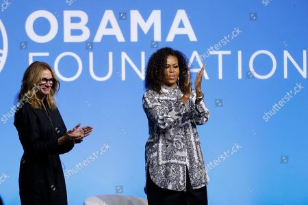 Stock Photo of Michelle Obama, Julia Roberts. Former U.S. fist lady Michelle Obama, right, and actress Julia Roberts gesture during an event for the Obama Foundation in Kuala Lumpur, Malaysia, . The former first lady and actress Roberts attend the inaugural Gathering of Rising Leaders in the Asia Pacific organized by the Obama Foundation
