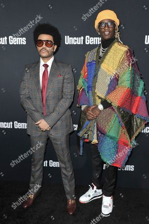 """The Weeknd, Young Thug. The Weeknd, left, and Young Thug attend the LA premiere of """"Uncut Gems"""" at ArcLight Hollywood, in Los Angeles"""