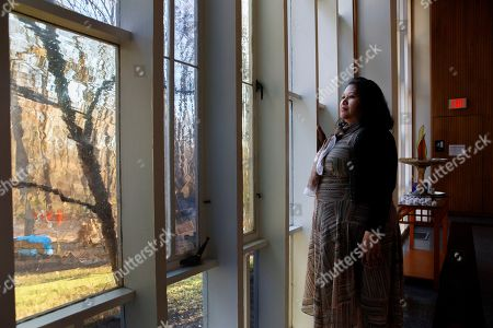 Rosa Gutierrez Lopez, from el Salvador, who a year ago became the first unauthorized immigrant to get refuge inside a religious institution in the Washington area, poses for a portrait at Cedar Lane Unitarian Universalist Church where she has been living in sanctuary for a year due to a deportation order, in Bethesda, Md