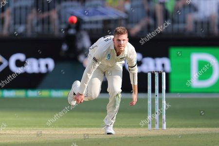 New Zealand's Lockie Ferguson bowls to Australia's Steve Smith during play in their cricket test in Perth, Australia