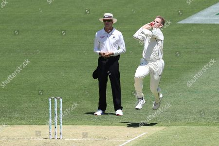 Stock Photo of New Zealand's Lockie Ferguson bowls to Australia's David Warner during play in their cricket test in Perth, Australia