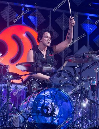 Ashton Irwin of the band 5 Seconds of Summer performs in concert during Q102's iHeartRadio Jingle Ball 2019 at the Wells Fargo Center, in Philadelphia