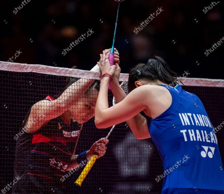 Ratchanok Intanon of Thailand (R) congratulates Tzu Ying Tai of Taiwan (L) after a women's singles match of the BWF World Tour Finals Badminton tournament at Tianhe Gymnasium in Guangzhou, China, 12 December 2019.