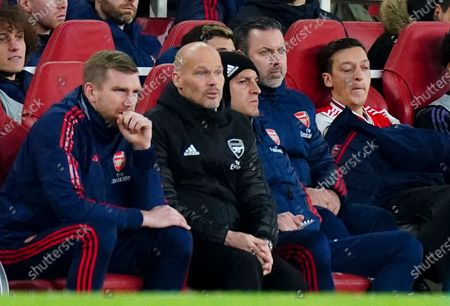 Interim Manager Freddie Ljungberg of Arsenal stifles a yawn after being substituted by Interim Manager Freddie Ljungberg