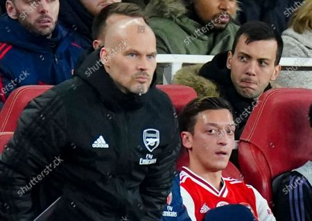 Mesut Ozil of Arsenal looks towards Interim Manager Freddie Ljungberg after being substituted