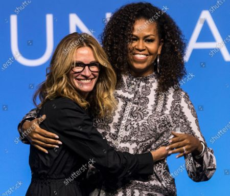 Former US first lady Michelle Obama (R) hugs US actress Julia Roberts at the end of an Obama Foundation event in Kuala Lumpur, Malaysia, 12 December 2019.
