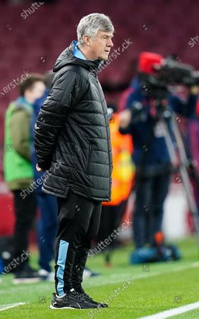 Brian Kidd Manchester City Assistant Manager looks on as the players warm up before kick-off