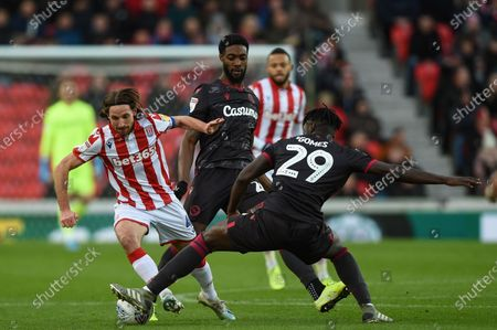 14th December 2019, Bet365 Stadium, Stoke-on-Trent, England; Sky Bet Championship, Stoke City v Reading : Joe Allen (4) of Stoke City is tackled by Pele (29) of Reading Credit: Richard Long/News Images