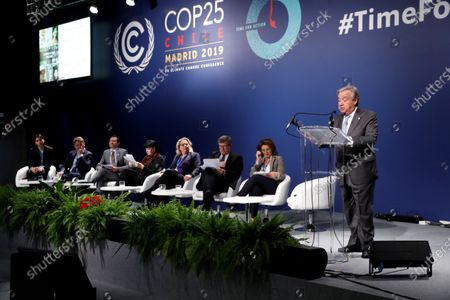 Stock Photo of United Nations (UN) Secretary General Antonio Guterres (R) delivers a speech during the round table talks on 'Climate Action for Jobs Initiative' at the COP25 UN Climate Change Conference in Madrid, Spain, 12 December 2019. The 2019 United Nations Climate Change Conference (COP25) under the presidency of the government of Chile runs from 02 to 13 December 2019 in the Spanish capital.