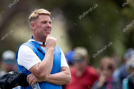 Former Australian test cricketer Shane Warne watches from the fairway during round 2 of The Presidents Cup