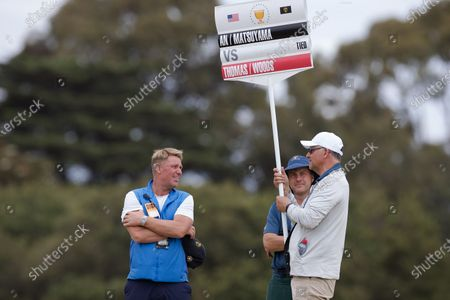 Cricket legend Shane Warne watching Tiger Woods of team USA during round 2 of The Presidents Cup