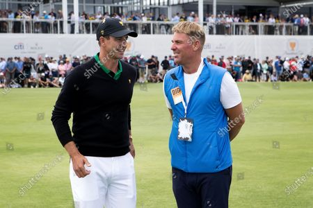 Cricket legend Shane Warne with Adam Scott of Australia during round 2 of The Presidents Cup