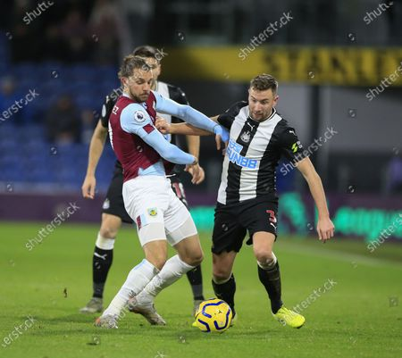 14th December 2019, Turf Moor, Burnley, England; Premier League, Burnley v Newcastle United : Paul Dummett (3) of Newcastle United and Jay Rodriguez (19) of Burnley challenge for the ball