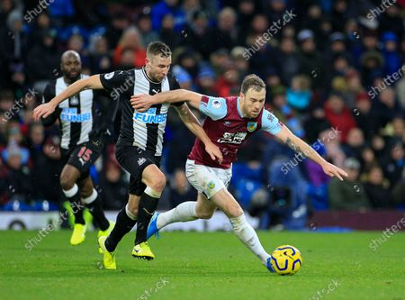 14th December 2019, Turf Moor, Burnley, England; Premier League, Burnley v Newcastle United : Ashley Barnes (10) of Burnley and Paul Dummett (3) of Newcastle United challenge for the ball