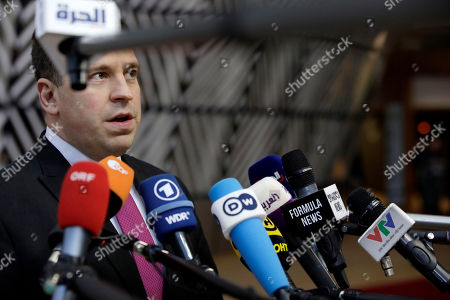 Estonian Prime Minister Juri Ratas speaks with the media as he arrives for an EU summit in Brussels, . European Union leaders gather for their year-end summit and will discuss climate change funding, the departure of the UK from the bloc and their next 7-year budget