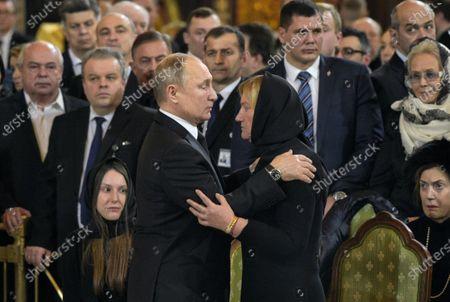 Final farewell to Ex-Mayor of Moscow Yury Luzhkov in the Cathedral of Christ the Savior. Russian President Vladimir Putin (center) and Yury Luzhkov's widow Elena Baturina (right)