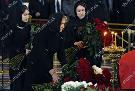 Final farewell to Ex-Mayor of Moscow Yury Luzhkov in the Cathedral of Christ the Savior. Yury Luzhkov's widow Elena Baturina (center) and his daughters Elena Luzhkova (right) and Olga Luzhkova (left)