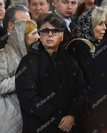 Stock Picture of Final farewell to Ex-Mayor of Moscow Yury Luzhkov in the Cathedral of Christ the Savior. Russian fashion designer Valentin Yudashkin (center)