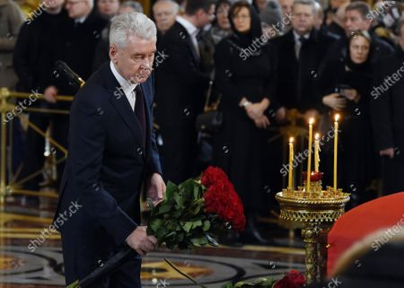 Stock Image of Final farewell to Ex-Mayor of Moscow Yury Luzhkov in the Cathedral of Christ the Savior. Moscow Mayor Sergei Sobyanin