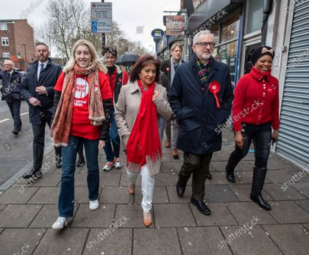 Jeremy Corbyn Leader of the Labour Party with his wife Laura Alvarez and fellow supports leaves his home and walks to the polling Station in Islington to cast his vote in today's General Election.