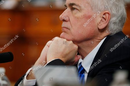 Rep. Tom McClintock, R-Calif., listens during a House Judiciary Committee markup of the articles of impeachment against President Donald Trump, on Capitol Hill in Washington