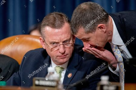 Ranking Member Doug Collins, R-Ga., left, speaks with Republican staff attorney Steve Castor, right, during a House Judiciary Committee markup of the articles of impeachment against President Donald Trump, on Capitol Hill in Washington