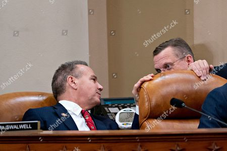 House Judiciary Committee ranking member Rep. Doug Collins, R-Ga., right talks with Rep. David Cicilline, D-R.I., during a House Judiciary Committee markup of the articles of impeachment against President Donald Trump, on Capitol Hill in Washington