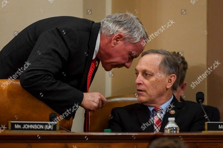 Ken Buck, Andy Biggs. Rep. Ken Buck, R-CO., left, talks with Rep. Andy Biggs, R-Ariz., during a House Judiciary Committee markup of Articles of Impeachment against President Donald Trump, on Capitol Hill in Washington