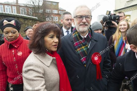 British Labour Party Leader Jeremy Corbyn (R, front) and his wife Laura Alvarez (L, front) leave a polling station after casting their votes for the general election in London