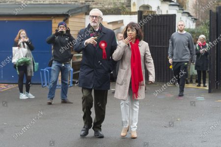 British Labour Party Leader Jeremy Corbyn (L, front) and his wife Laura Alvarez (R, front) arrive at a polling station to cast their votes for the general election in London
