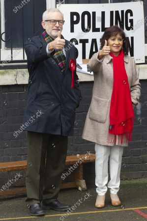 British Labour Party Leader Jeremy Corbyn and his wife Laura Alvarez pose at a polling station after casting their votes for the general election in London
