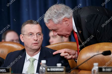 House Judiciary Committee ranking member Doug Collins (L) talks with Republican Representative from (R) and Republican Representative from Colorado Ken Buck (R) during the House Judiciary Committee's markup of House Resolution 755, Articles of Impeachment Against President Donald J. Trump on Capitol Hill in Washington, DC, USA, 12 December 2019. The House Judiciary Committee has written two articles of impeachment accusing US President Donald J. Trump of abuse of power and obstruction of Congress. The committee is expected to vote on the two articles, 12 December, setting up a vote on the House floor next week.