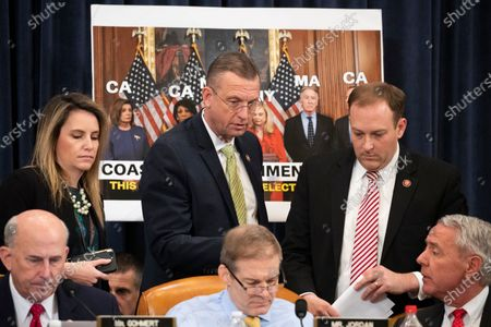 House Judiciary Committee ranking member Doug Collins (Top C), Republican Representative from New York Lee Zeldin (Top R), Republican Representative from Colorado Ken Buck (Bottom R), Republican Representative from Ohio Jim Jordan (Bottom C) and Republican Representative from Texas Louie Gohmert (Bottom L) speak with one another during the House Judiciary Committee's markup of House Resolution 755, Articles of Impeachment Against President Donald J. Trump, on Capitol Hill in Washington, DC, USA, 12 December 2019. The House Judiciary Committee has written two articles of impeachment accusing US President Donald J. Trump of abuse of power and obstruction of Congress. The committee is expected to vote on the two articles, 12 December, setting up a vote on the House floor next week.