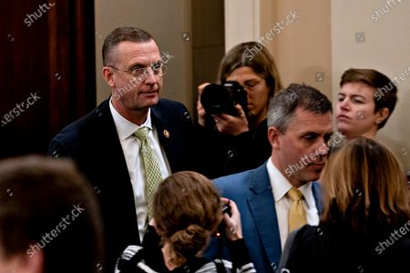 Representative Doug Collins, a Republican from Georgia and ranking member of the House Judiciary Committee, exits during a break from a hearing in Washington, D.C., U.S., 12 December 2019. The Judiciary Committee is set to finish debating articles of impeachment against President Donald Trump today with a likely party-line vote to send the resolution to the floor of the House. Photographer: Andrew Harrer/Bloomberg