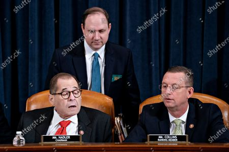 Representative Doug Collins, a Republican from Georgia and ranking member of the House Judiciary Committee, right, talks to chairman Representative Jerrold Nadler, a Democrat from New York, during a House Judiciary Committee hearing in Washington, D.C., U.S., 12 December 2019. The Judiciary Committee is set to finish debating articles of impeachment against President Donald Trump today with a likely party-line vote to send the resolution to the floor of the House. Photographer: Andrew Harrer/Bloomberg